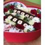 Композиция с красными розами, шоколадом и рафаэлло в коробке-сердце
